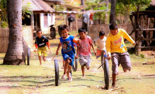 Kids playing with a wheel