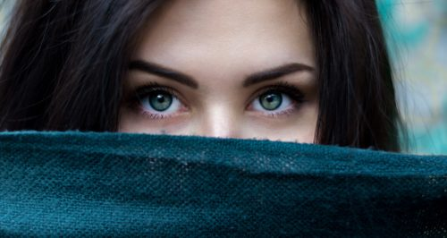 Green eyes of a Caucasian woman