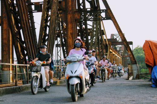 Motorbikes crossing the bridge in Vietnam